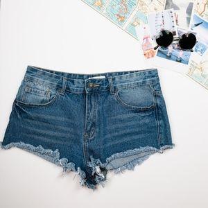 Cheeky Frayed Edge Medium Wash Jean Shorts